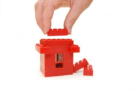 constructed: Small house constructed of red toy blocks Stock Photo