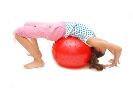 beautiful young girl with ball exercising photo