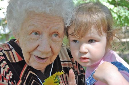 tells: grandmother tells a fairy tale to the grand daughter