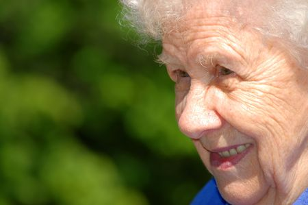 Portrait of the old woman on a green background Stock Photo - 5046486