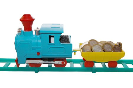 Toy train carrying coins on a white background Stock Photo - 5097000