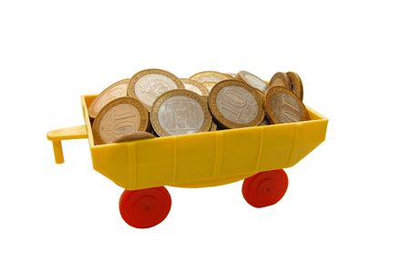 Toy train carrying coins on a white background Stock Photo - 5097031