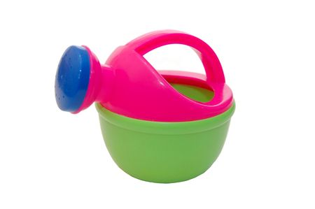 multi-colour toy watering can on white  background photo