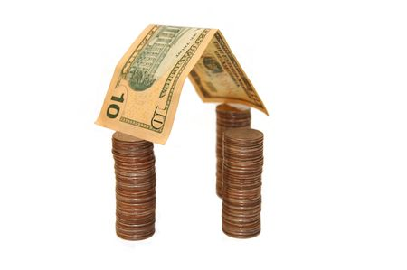 House made of money isolated on white background photo