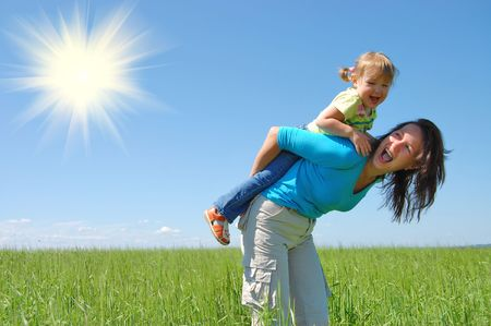 healthy life: family mother and child under blue sky