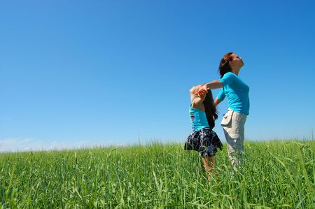 Friendship and happiness of mum and daughter against the blue sky Stock Photo - 5130035