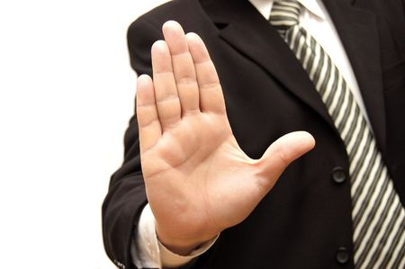 upraised: Men hand signaling stop against isolated on white background     Stock Photo