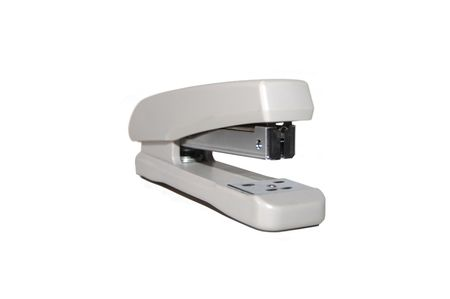 Grey office stapler on a white background photo