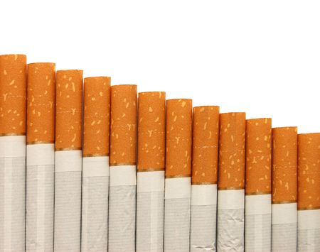 cigarette smoke: row of cigarettes on white background Stock Photo