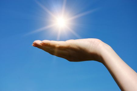 hand hold against blue sky     photo