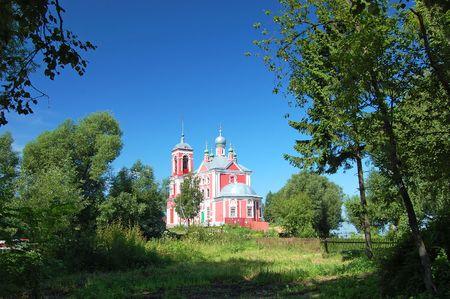 Russian nature against ancient church photo