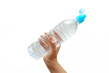 Hand with bottle of water isolated on white background photo