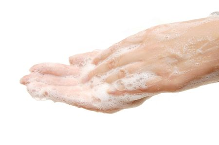 dispense: Female hands in soapsuds isolated on white Stock Photo