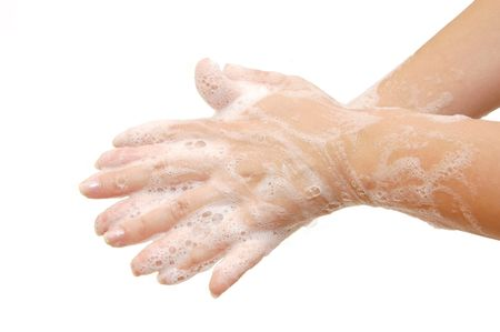 soapsuds: Female hands in soapsuds isolated on white Stock Photo