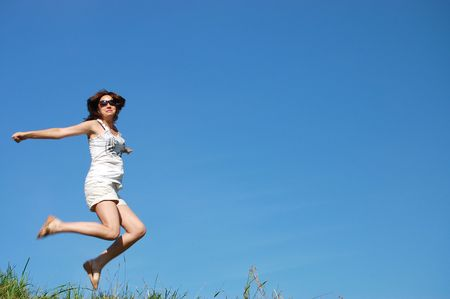 girl jumping against the beautiful sky Stock Photo - 5345480