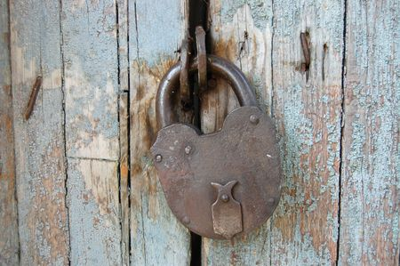 The old lock against a wooden door Stock Photo - 5391253