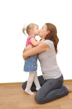 Mother and her little daughter on wooden  floor photo