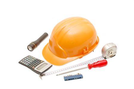 Orange helmet and the tool isolated on white background photo