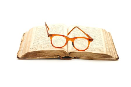 open old book and glasses photo