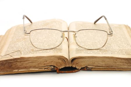 old book and glasses on it photo