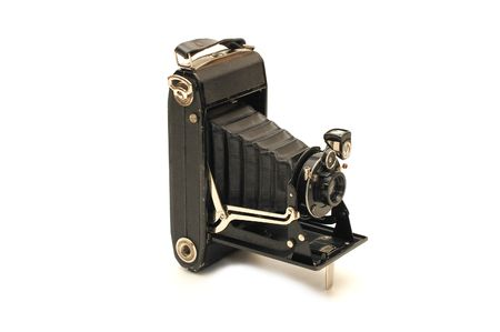 medium format retro camera isolated on white   photo