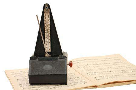 metronome on sheet music background photo