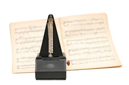 minuet: metronome on sheet music background