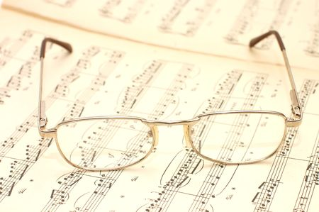 chorale: Close up photo of glasses on sheet music   Stock Photo