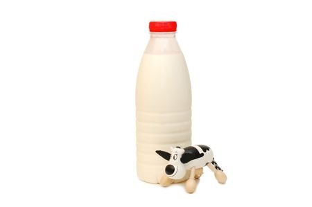 Bottle of Milk and toy cow  photo