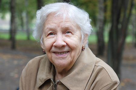 Beautiful portrait of an elder woman outdoors  Stock Photo - 5567037