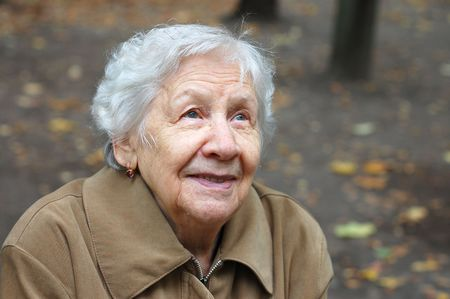 Portrait of the old woman on a autumn background Stock Photo - 5567080