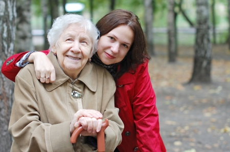 old people in care: Grandmother and granddaughter embraced and happy