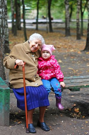 grandchild: portrait of a grandmother and granddaughter in the park Stock Photo