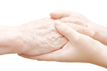 touching hands: old and young hands isolated on white Stock Photo