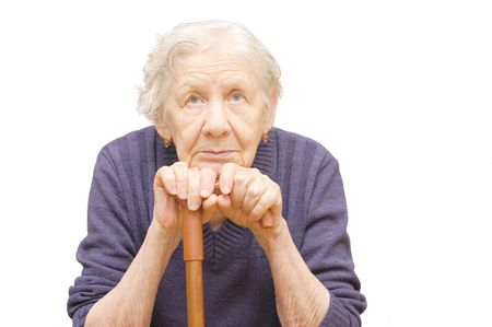 Grandmother holding a cane on white background Stock Photo - 5593893