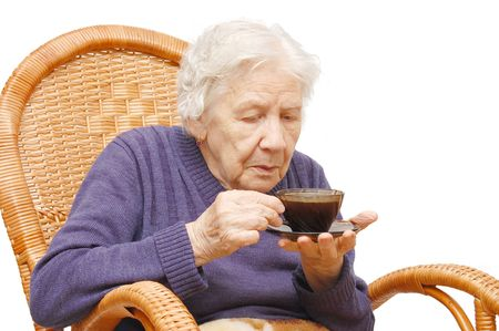 Grandmother from coffee in an armchair Stock Photo - 5593888