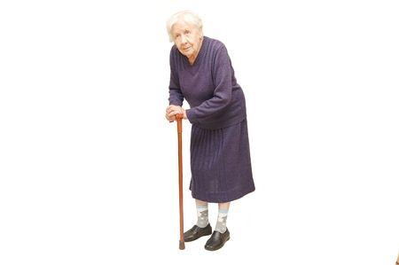 senioren wandelen: Grootmoeder met een stok op een witte achtergrond Stockfoto