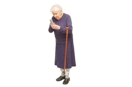 leans on hand: Grandmother holding a cane on white background