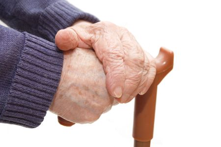 leans: Old woman hand leans on walking stick