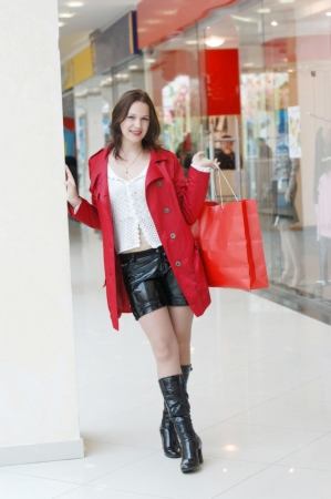 The girl doing purchase in shopping centre photo