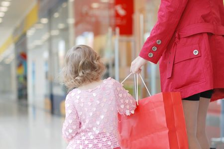 Mum and daughter in shopping centre photo