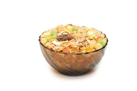 Transparent bowl with musli on white background   photo
