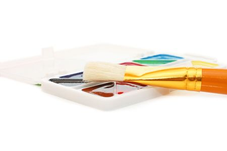 Water colour paints and brush  isolated on white  photo