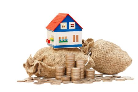 The toy house on bags with coins Stock Photo - 5784380
