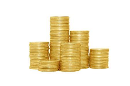 Goldenen M�nzen, die auf wei�en Hintergrund isoliert Lizenzfreie Bilder