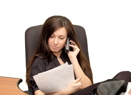 Girl in an armchair with phone Stock Photo - 5826105