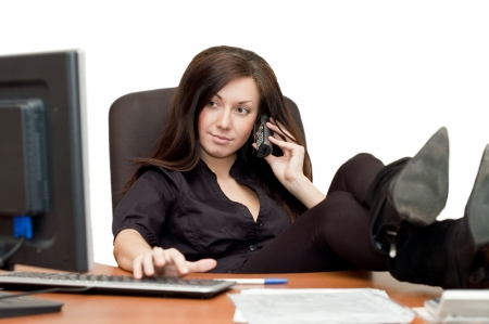 desk clerk: Girl in an armchair at the computer Stock Photo