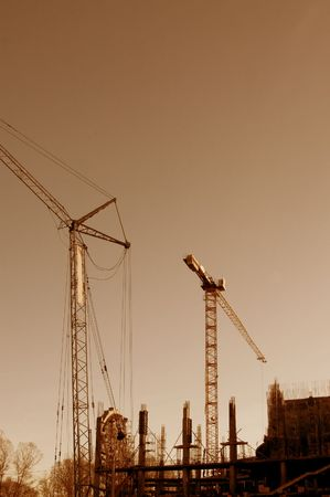 The elevating crane against the sky photo