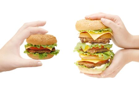 Two hamburgers in hands isolated on white  photo