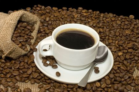 coffe break: Cup from coffee on coffee grains Stock Photo
